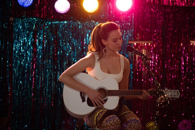 Liberty plays her music in Hollyoaks