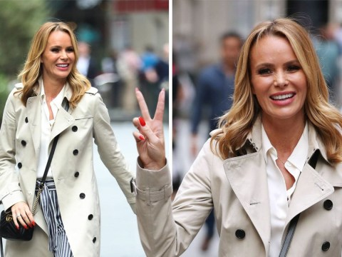 Calling for a truce? Amanda Holden makes peace sign on relaxed stroll amid Phillip Schofield 'feud' claims