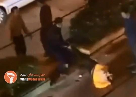 Iranian woman dragged across street