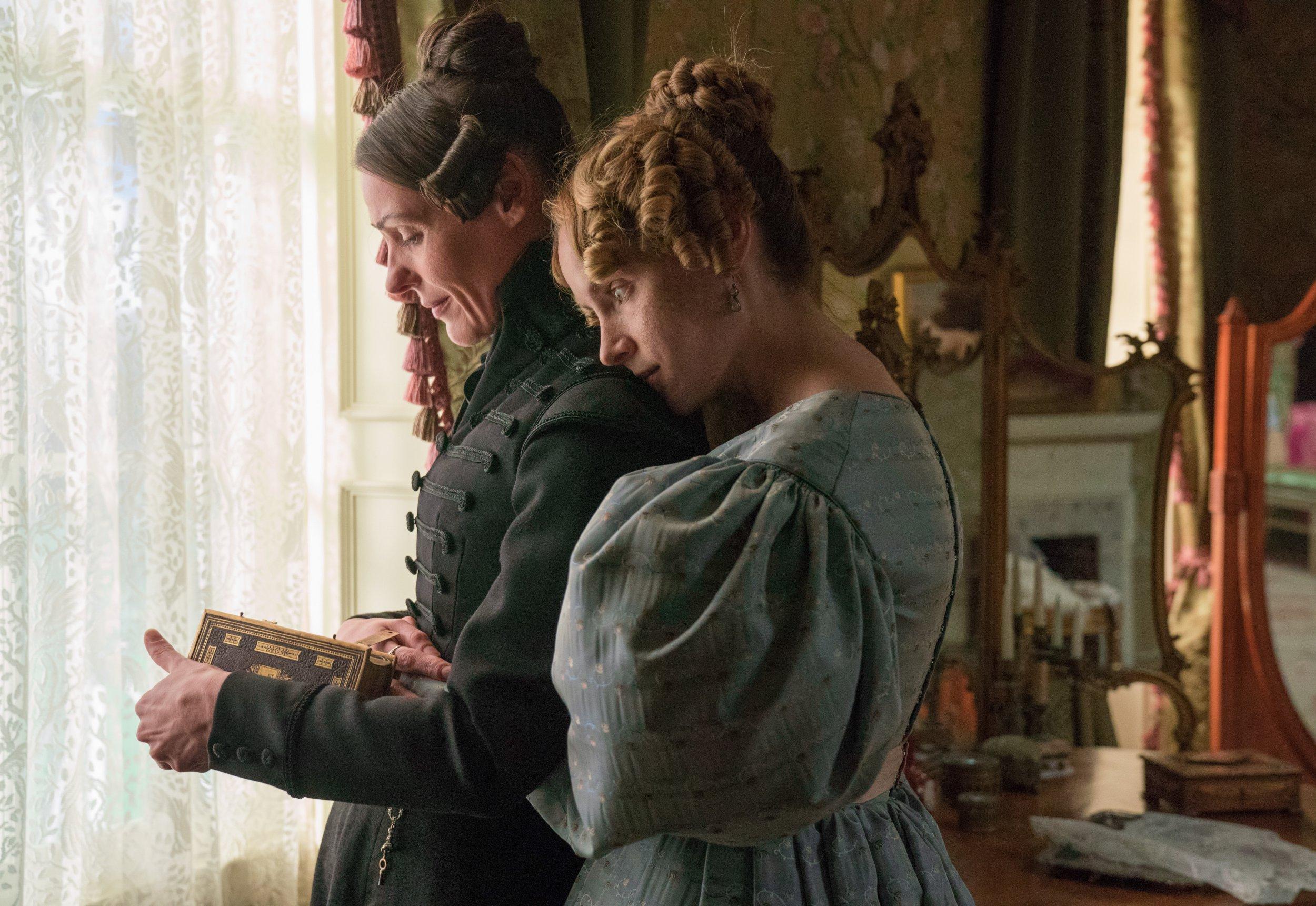 Women in Victorian dresses hugging