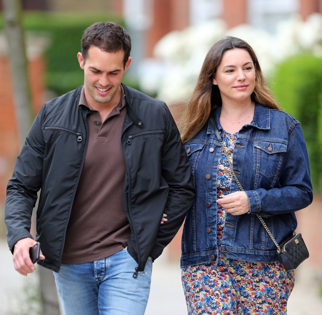 (EXCLUSIVE PICTURES ALL ROUND PAPERS ONLY) HAS KELLY BROOK GOT SECRETLY MARRIED TO JEREMY PARISI? Kelly Brook was all smiles as she steps out with boyfriend Jeremy Parisi in London. The Model/actress/TV presenter was wearing a denim jacket, floral jumpsuit and supporting a diamond ring and a band on her wedding finger. The loved up pair looked very much in love as they enjoyed a stroll in London. UK. 23/06/2019 BYLINE MUST READ : JAMESY/GOTCHA IMAGES Copyright by ? Gotcha Images Ltd. All rights reserved. Usage of this image is conditional upon the acceptance of Gotcha Images Ltd, terms and conditions available at www.gotchaimages.com