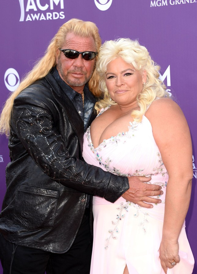 LAS VEGAS, NV - APRIL 07: TV personalities Dog the Bounty Hunter (L) and Beth Chapman arrive at the 48th Annual Academy of Country Music Awards at the MGM Grand Garden Arena on April 7, 2013 in Las Vegas, Nevada. (Photo by Jason Merritt/Getty Images)