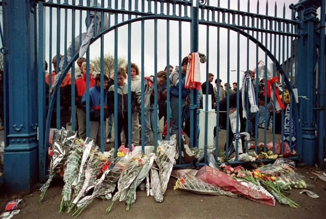 FILE PHOTO: Hillsborough match commander David Duckenfield, 74, will face a retrial over the gross negligence manslaughter of 95 Liverpool fans, judge Sir Peter Openshaw has ruled at Preston Crown Court. Fans leave flowers at the gates of Hillsborough ... Hillsborough Disaster - Nottingham Forest v Liverpool - F.A. Cup ... 16-04-1989 ... ... ... Photo credit should read: Ross Kinnaird/EMPICS Sport. Unique Reference No. 220540 ... SOCCER ERIC CANTONA RIDING A SKI BIKE , or SNOW CAT