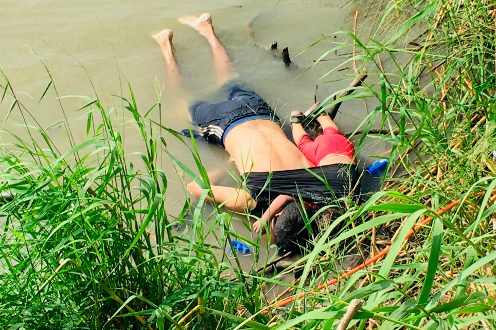 ADDS THAT PHOTO WAS FIRST PUBLISHED IN MEXICAN NEWSPAPER LA JORNADA - EDS NOTE: GRAPHIC CONTENT - The bodies of Salvadoran migrant Oscar Alberto Mart??nez Ram??rez and his nearly 2-year-old daughter Valeria lie on the bank of the Rio Grande in Matamoros, Mexico, Monday, June 24, 2019, after they drowned trying to cross the river to Brownsville, Texas. Martinez' wife, Tania told Mexican authorities she watched her husband and child disappear in the strong current. This photograph was first published in the Mexican newspaper La Jornada. (AP Photo/Julia Le Duc)