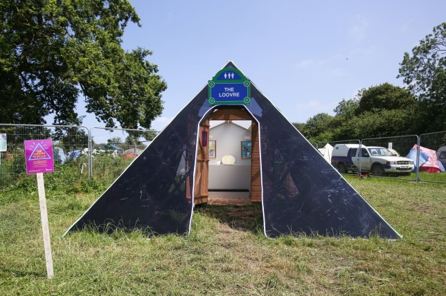 Need to pop to the Loovre? There's a toilet cubicle with an art gallery inside at Glastonbury