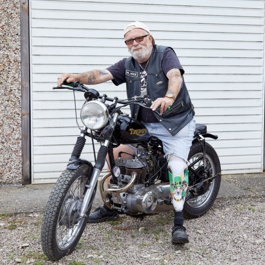 PIC FROM Mercury Press - (PICTURED: Michael Jackson, 72, from Langtoft, Lincs, showing his prosthetic leg with an image of his dog Charlie on) - A biker dad left devastated by the death of his favourite dog has been reunited with him in spirit after having the pooch's face SUPERIMPOSED on his prosthetic leg. Retired bus driver, Michael Jackson, 72, from Langtoft, Lincs, lost beloved Jack Russell-Chihuahua cross Charlie just a month before his leg had to be amputated after a horror motorbike smash in September 2017.Dad-of-one Michael was so close with the pooch he had a special device fitted to his bike so that they could ride together and was left heartbroken when Charlie died of a heart attack in his arms.SEE MERCURY COPY
