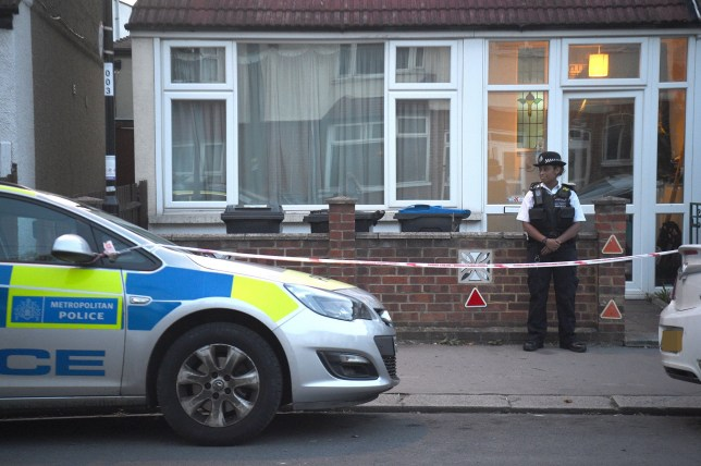 Police at the scene in Raymead Avenue, Thornton Heath, Croydon where a women who was around eight months pregnant has been stabbed to death and her baby is critically ill in hospital.