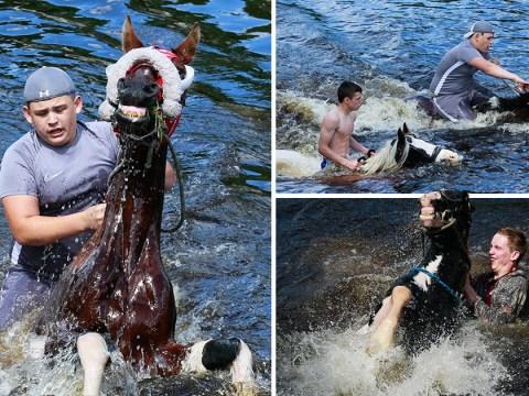Travellers ride horses through the river as Appleby Horse Fair 2019 kicks off