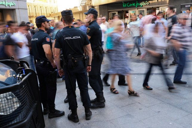 National Police officers stand guard near Sol square the day before of the Champions League soccer final in downtown Madrid, Spain, Friday, May 31, 2019. Madrid will be hosting the final again after nearly a decade, but the country's streak of having at least one team playing for the European title ended this year after five straight seasons, giving home fans little to cheer for when Liverpool faces Tottenham at the Wanda Metropolitano Stadium on Saturday. (AP Photo/Francisco Seco)