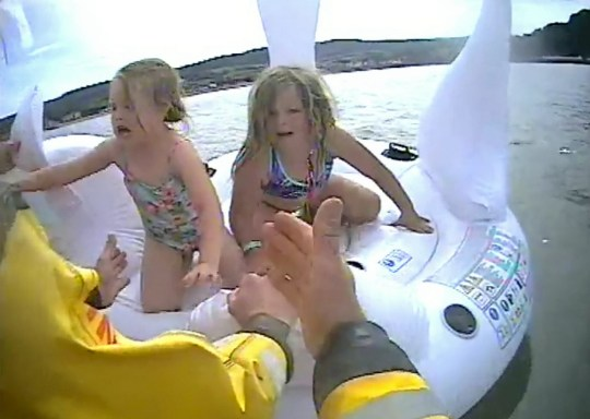 Moment heroic lifeguards save two girls swept out to sea