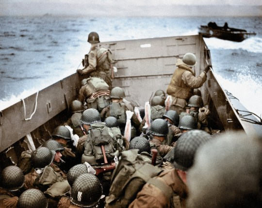 A Landing Craft, Vehicle, Personnel (LCVP) is approaching Omaha Beach, Normandy, France, 6th June 1944. To the right is another LCVP. The soldiers are protecting their weapons with Pliofilm covers against the wetness. These U.S. Army infantry men are amongst the first to attack the German defenses probably near Ruquet ? Saint Laurent sur Mer. Photo: Robert F. Sargent, U.S. Coast Guard (USCG). Normandy, France. (Photo by Galerie Bilderwelt/Getty Images)