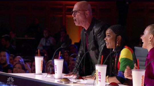 """BGUK_1613614 - ** RIGHTS: WORLDWIDE EXCEPT IN UNITED STATES ** Los Angeles, CA - Howie Mandel climbs onto desk to jump on golden buzzer for singer Joseph Allen during America's Got Talent auditions. Allen earned the Golden Buzzer from judge Mandel on after performing an original song. Friends and family gave him as standing ovation even before he sang a note, moved by his positive attitude and heart. """"I just wanna see how much of a footprint I can leave on the earth before I leave,"""" the 21-year-old student from Killeen, Texas, said onstage as he introduced himself to the judges - Mandel, Simon Cowell, Julianne Hough and Gabrielle Union. Howie was charmed by his 'exuberance electric smile'. ''Life is a series of moments,"""" Mandel told Joseph. """"People at home are talking about this moment. People in this room are talking about this moment. People -"""" he continued, suddenly beginning to crawl onto the table in front of him, """"-just want this moment to happen."""" Howie then pointed out, standing up on the table top, adding: """"Now you said you wanna leave a footprint. Well, I'm gonna give you the footprint you need to leave."""" He then stomped on the Golden Buzzer sending Joseph straight to the live show. In the crowd, Joseph's loved ones went bananas. As one of 12 children raised in a 'blended' family, the singer had repeatedly called his parents and siblings a source of support. AGT host Terry Crews also ran out and scooped Joseph up, carrying him around the stage as golden confetti fell. Joseph had asked him to do so earlier if he got the Golden Buzzer. *BACKGRID DOES NOT CLAIM ANY COPYRIGHT OR LICENSE IN THE ATTACHED MATERIAL. ANY DOWNLOADING FEES CHARGED BY BACKGRID ARE FOR BACKGRID'S SERVICES ONLY, AND DO NOT, NOR ARE THEY INTENDED TO, CONVEY TO THE USER ANY COPYRIGHT OR LICENSE IN THE MATERIAL. BY PUBLISHING THIS MATERIAL , THE USER EXPRESSLY AGREES TO INDEMNIFY AND TO HOLD BACKGRID HARMLESS FROM ANY CLAIMS, DEMANDS, OR CAUSES OF ACTION ARISING OUT OF OR CONNECTED IN ANY """