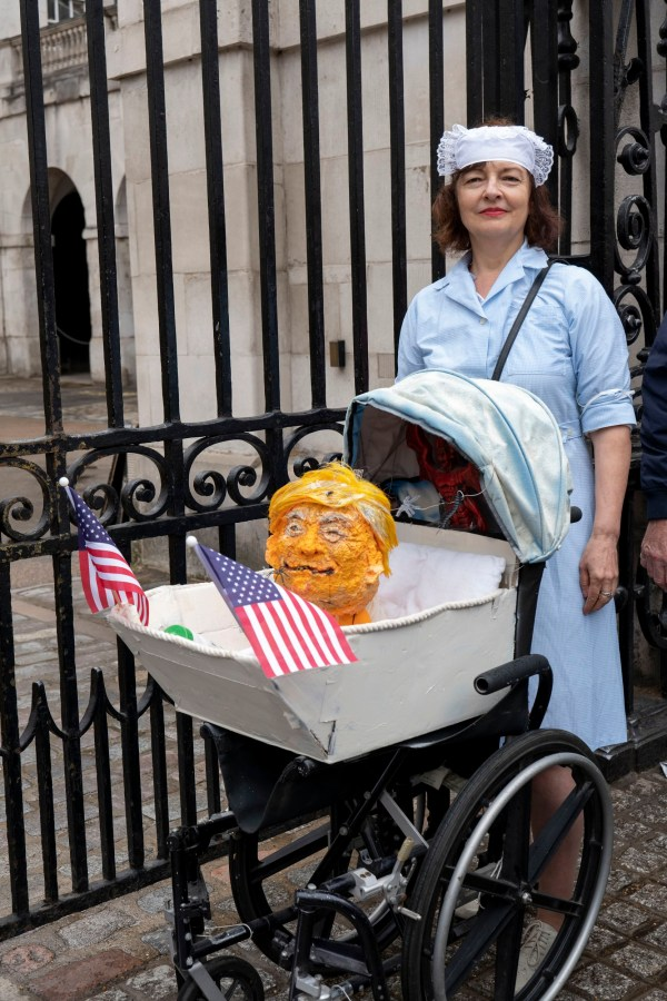 An NHS nurse taking part in the Stop Donald Trump march through London during his UK visit on June 4