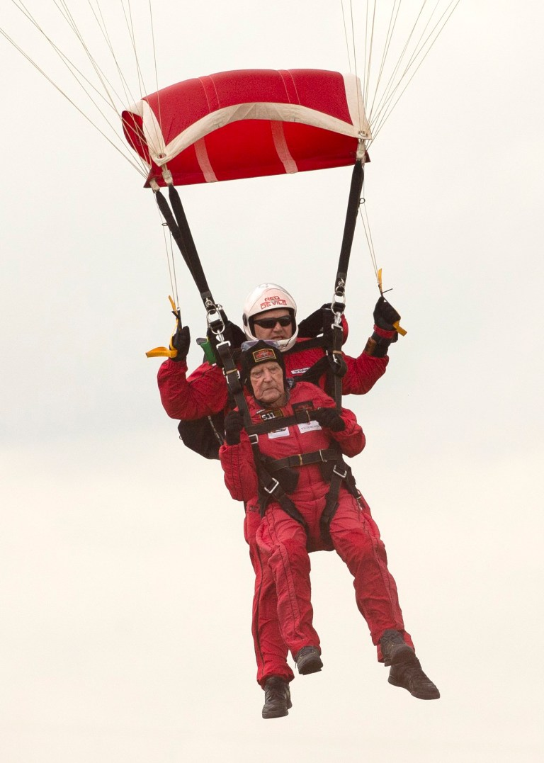 Veteran jJohn 'Jock' Hutton, 94, from Stirling, completes his tandem parachute jump with the Red Devils during the Commemorative Parachute Descent over Sannerville, France, during commemorations for the 75th anniversary of the D-Day landings.
