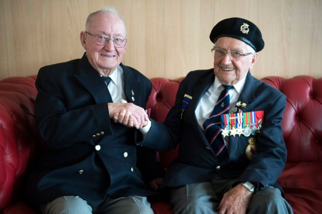 Ernest Green (left) and Bob Barnett shake hands on the MV Boudicca at Portsmouth after they discovered that they were on the same boat on D-Day on 6th June 1944. PRESS ASSOCIATION Photo. Picture date: Wednesday June 5, 2019. They were both on HMS Redpole when it sailed to Juno beach on June 6, 1944 and spent three years together on the ship, finally returning home in 1946, but after stepping off the ship, they did not see each other again, until Wednesday. See PA story MEMORIAL DDay Redpole. Photo credit should read: Kirsty O'Connor/PA Wire