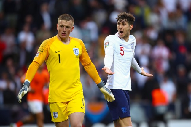 John Stones of England argues with goalkeeper Jordan Pickford during the UEFA Nations League Semi-Final match between the Netherlands and England at Estadio D. Afonso Henriques on June 6, 2019 in Guimaraes, Portugal. (Photo by Robbie Jay Barratt - AMA/Getty Images)