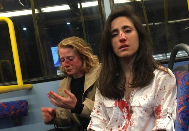 ?We were seen as entertainment, that?s what makes me so angry? This horrifying picture shows a Ryanair flight attendant and her girlfriend covered in blood after a gang of men savagely attacked them on a London bus. Melania Geymonat, 28, from Uruguay was riding the bus with her American girlfriend Chris after an evening out in West Hampstead in the early hours of Thursday May 30. Melania, who lives in Bishop's Stortford in Essex, says the pair decided to sit at the front on the top deck because they both enjoy the novelty of a double decker bus. Then a gang of young men behind them saw they were a couple and started to demand they kiss while making crude sexual gestures. She said: ?They wanted us to kiss so they could watch us. I tried to defuse the situation as I?m not a confrontational person, telling them to please leave us alone as Chris wasn?t feeling well.? The men, who were in their 20s or 30s, began throwing things and the couple told them to stop. ?The next thing I remember was Chris in the middle of them and they were beating her,? Melania added. ?I didn?t think about it and went in. I was pulling her back and trying to defend her so they started beating me up. ?I don?t even know if I was knocked unconscious. ?I felt blood, I was bleeding all over my clothes and all over the floor. ?We went downstairs and the police were there.? Melania is waiting to find out if her nose was broken in the vile attack. She said there were at least four of them and one spoke Spanish while the others had a British accent. The attackers also robbed the couple before fleeing the bus. Melania, who moved to the UK in February and is on a year's sabbatical from her medical studies, says she felt safe as a gay woman in London and was stunned by the attack. She released the picture to raise awareness of violence against women and gay people. She added: ?It?s not something isolated, it?s common. We were seen as entertainment, that?s what makes me so angry.? The Met has been contacted