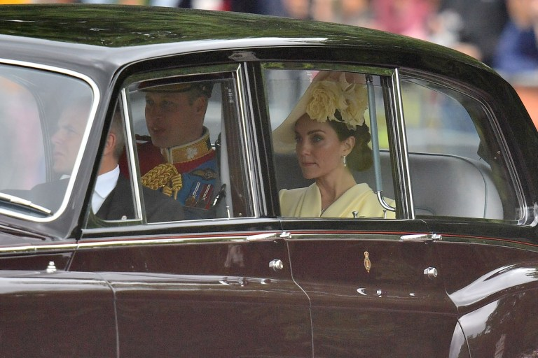 Britain's Prince William, Duke of Cambridge, (C) and Britain's Catherine, Duchess of Cambridge (R) are driven to Horseguards parade ahead of the Queen's Birthday Parade, 'Trooping the Colour', in London on June 8, 2019. - The ceremony of Trooping the Colour is believed to have first been performed during the reign of King Charles II. Since 1748, the Trooping of the Colour has marked the official birthday of the British Sovereign. Over 1400 parading soldiers, almost 300 horses and 400 musicians take part in the event. (Photo by Daniel LEAL-OLIVAS / AFP)DANIEL LEAL-OLIVAS/AFP/Getty Images