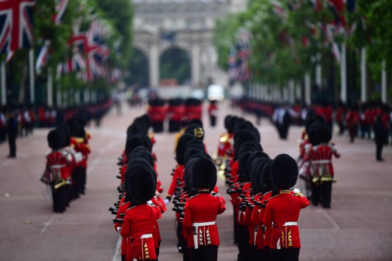 Soldiers makes their way from Buckingham Palace to Horse Guards Parade, in London, ahead of the Trooping the Colour ceremony, as Queen Elizabeth II celebrates her official birthday. PRESS ASSOCIATION Photo. Picture date: Saturday June 8, 2019. See PA story ROYAL Trooping. Photo credit should read: Victoria Jones/PA Wire