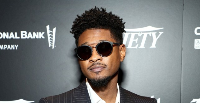 Usher poses on red carpet at Variety's Power Of Law event