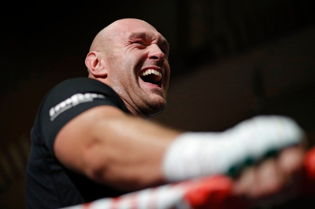 Tyson Fury, of England, laughs as he works out for fans and the media Tuesday, June 11, 2019, in Las Vegas. Fury is scheduled to fight Tom Schwarz, of Germany, in a heavyweight bout Saturday in Las Vegas. (AP Photo/John Locher)