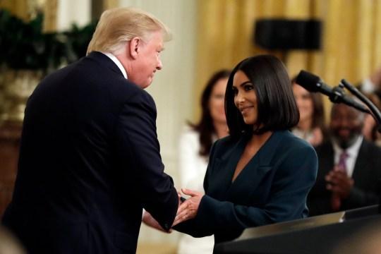 President Donald Trump shakes hands with Kim Kardashian West