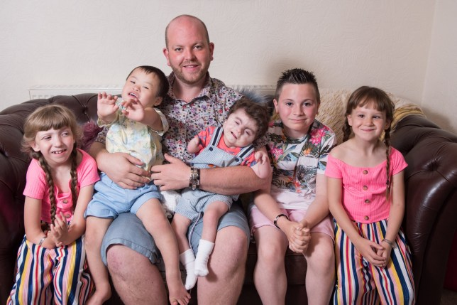 Pic by Caters News - (Pictured: L-R Lily, Joseph, Noah, Jack, Ruby with dad Ben Carpenter.) - A single dad is looking forward to a very special Fathers Day as adopted his FIFTH disabled child to join his growing family after first adopting aged 21. Ben Carpenter, 35, from Shepley, West Yorkshire, who is dubbed a super dad by his friends and family, initially only wanted to adopt one child. But ten years on, Ben has just become a dad-of-five after finalising the adoption of his son, Noah - who has Cornelia de Lange syndrome - and doesnt write off adopting more. With a range of disabilities, his children, Jack, Ruby, Lily, Joseph and Noah, all have complex needs; from Autism to Pierre Robin syndrome. SEE CATERS COPY.