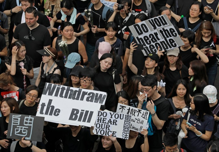Protesters march through the streets of Hong Kong
