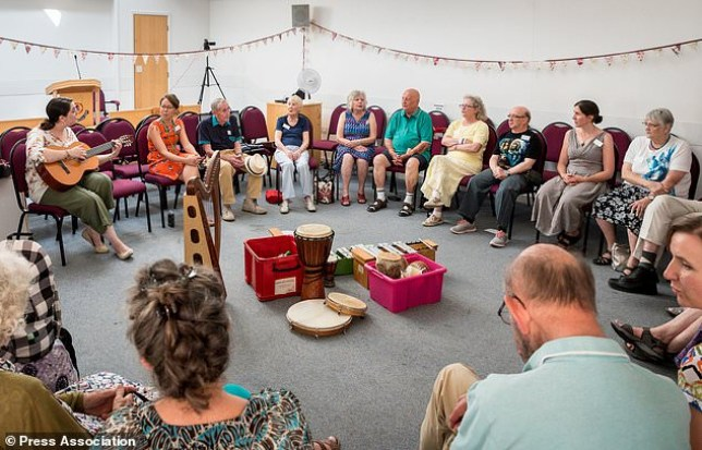 eople living with dementia and their carers attend a music therapy session at the Salvation Army Hall in Saffron Walden, Essex (Picture: Roger King/PA)