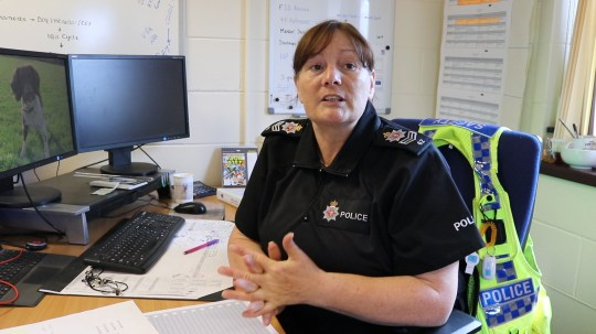 Laura Forster, wearing her uniform, sat at a desk