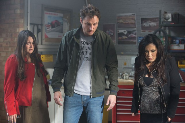 Kat, Martin and Stacey stare down at Phil in Eastenders