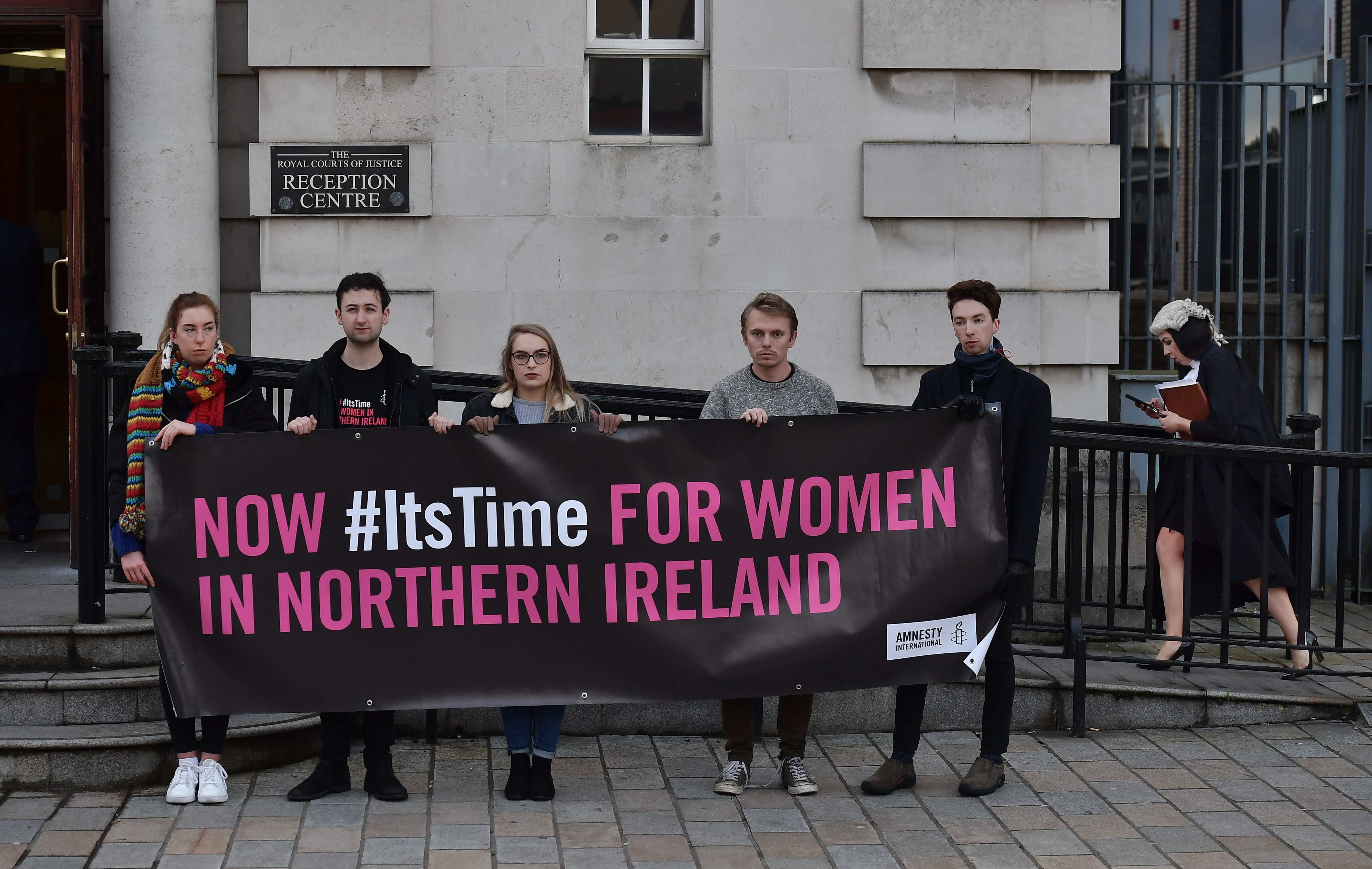 Campaigners hold a pro-choice banner as the protest for the legalization of abortion in Northern Ireland