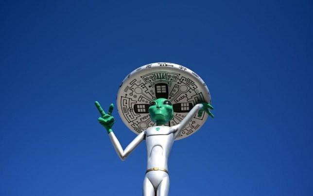 a sculpture of an alien