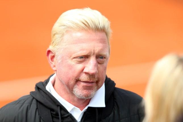 Boris Becker looks on