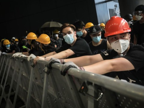 When was Hong Kong's handover to China and why are people protesting?