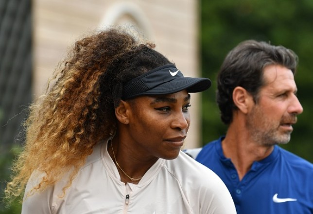 Serena Williams looks on followed by coach Patrick Mouratoglou