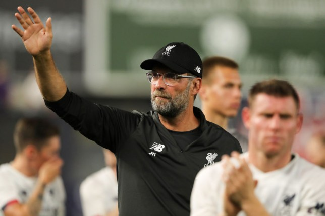 Jurgen Klopp waves during Liverpool match against Sporting CP at Yankee Stadium
