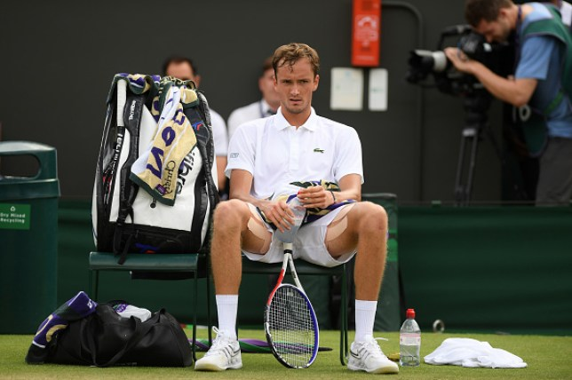 Daniil Medvedev looks on in anger as he sits on his chair at Wimbledon