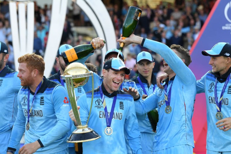 Captain Eoin Morgan is soaked in champagne