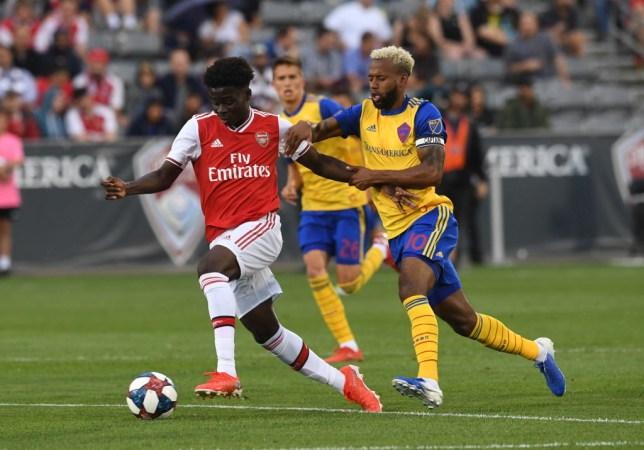 Bukayo Saka dribbles during Arsenal's game against Colorado Rapids