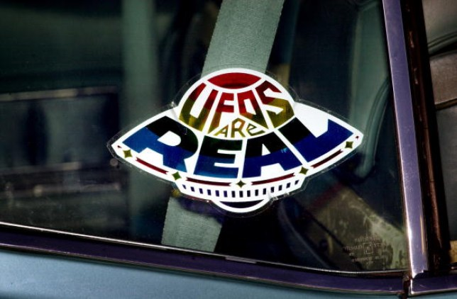 Car sticker shaped like a UFO that says UFOs are real