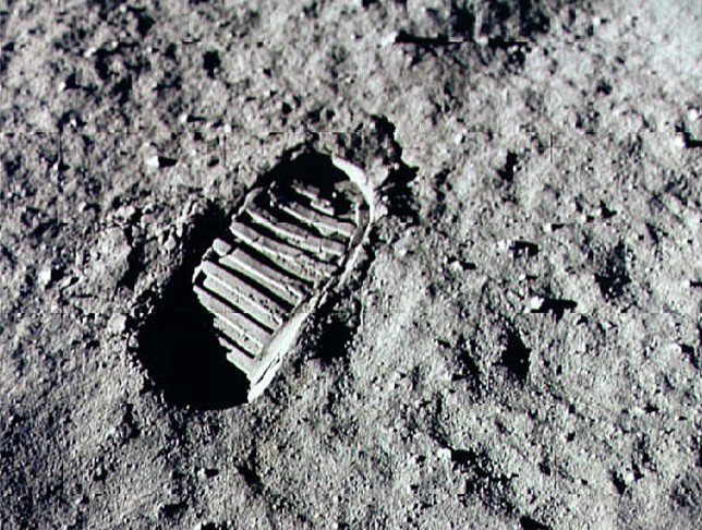 Neil Armstrong steps into history July 20, 1969 by leaving the first human footprint on the surface of the moon. (NASA/Newsmakers)