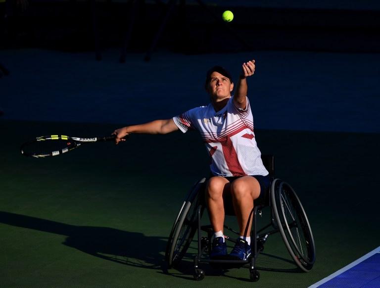 Cornelia Oosthuizen serving in a wheelchair tennis match