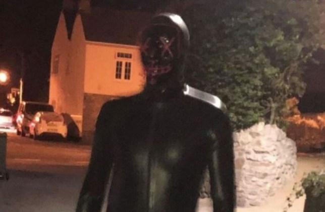 A man in a gimp suit terrorising village