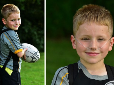 Boy with rare condition plays rugby with oxygen tank strapped to his back