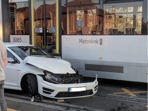 Moment car is crushed beneath tram after collision