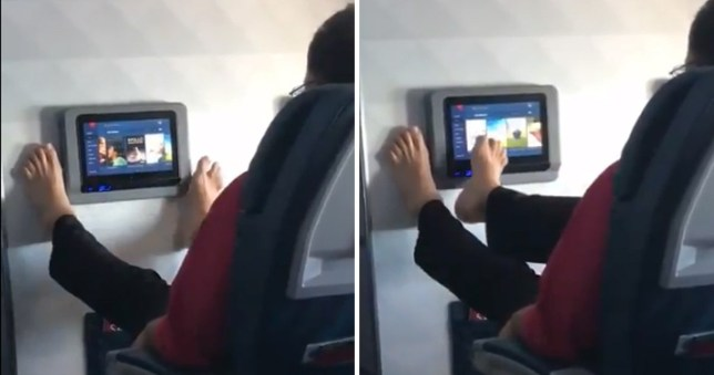 Man using his feet to control the in-flight entertainment