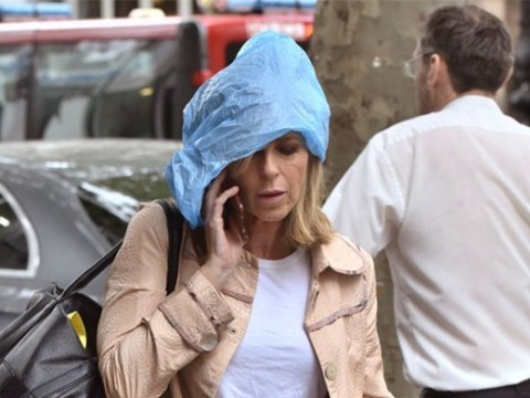 Kate Garraway couldn't give less of a sh*t as she swaps umbrella for plastic bag