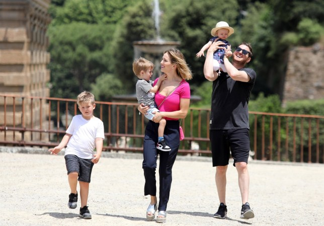 Michael Buble was all smiles during a stroll with his beautiful family in Italy