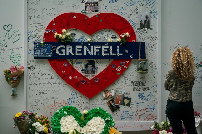 FILE PHOTO - People look at and leave messages near Grenfell Tower on the second anniversary of the tragedy. London. 14 June 2019. Campaigner Reverend Julyan Drew has been named Grenfell???s first community hero fopr his tireless fight for the victims of the tower tragedy - as he recieved the award on his hospice bed. See SWNS story SWPLgrenfell. A minister has been named Grenfell's first community hero for his continuing fight for the victims of the tragedy - and received the award in his hospice bed. Reverend Julyan Drew was forced to retire due to health issues last year but he has not stopped campaigning even while critically ill with cancer. And he has now been presented with the first Grenfell Community Hero Award in recognition of his battle for social justice. He recently decided to go ???Green for Grenfell???, a national initiative to show unity and support and honour the lives of those who perished in the tower inferno in June 2017.